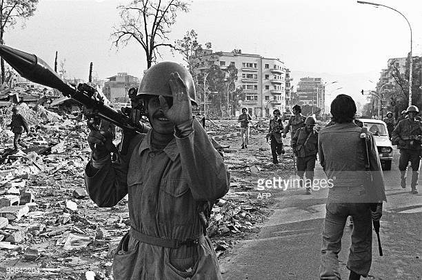 Syrian soldiers members of the joint Arab 'green helmets' peacekeeping force to Lebanon take position 15 November 1976 in Beirut In early June 1976...