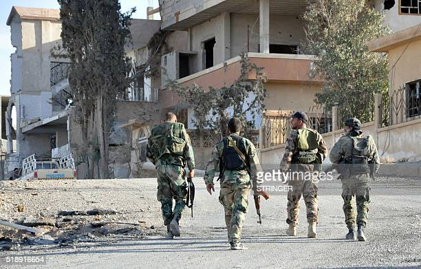 Syrian soldiers patrol the town of alQuaryatayn in Syria's central Homs province on April 3 2016 Syrian troops seized the key Islamic State group...