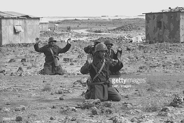 Syrian soldiers raise their hands in surrender October 10 1973 on the Golan Heights five days into the Yom Kippur War Israeli Prime Minister Ariel...