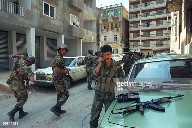 Syrian soldiers take position 17 April 1990 in one of West Beirut districts as they have been deployed after heavy interShi'ite clashes between...