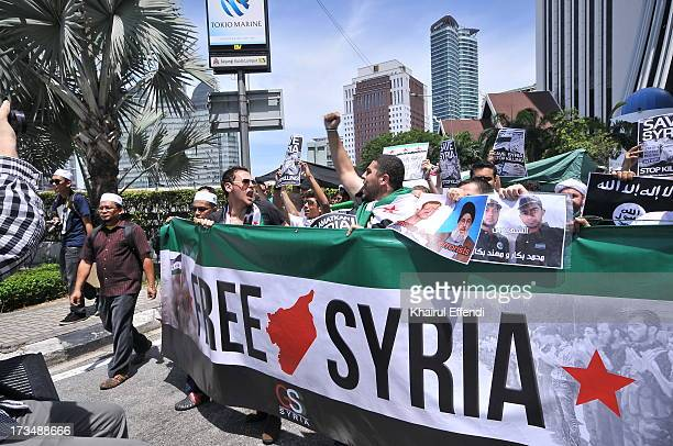 Syrian student in Malaysia on a demonstration for Syria in which where their country are at war because of Bashar Assad and their government.