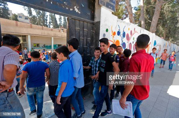 Syrian students from the former rebel held area of Eastern Ghouta arrive to attend class at a school in Kafr Batna on September 5 2018 Syrian troops...