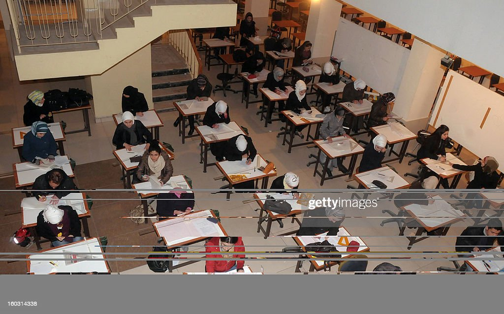 Syrian students from the University of Aleppo sit their exams on January 29, 2013 after the institution re-opened following an explosion earlier in the month, in northern Syria's city of Aleppo. The Britain-based Syrian Observatory for Human Rights confirmed the blast on January 15, which caused a number of causalities, but said its origin was unclear.