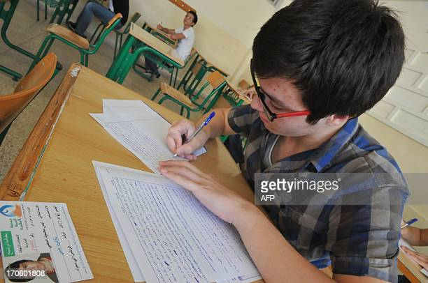 Syrian students take official exams in the northern Lebanese port town of Tripoli on June 15 2013 Some 16 million Syrians have fled since Syria's...