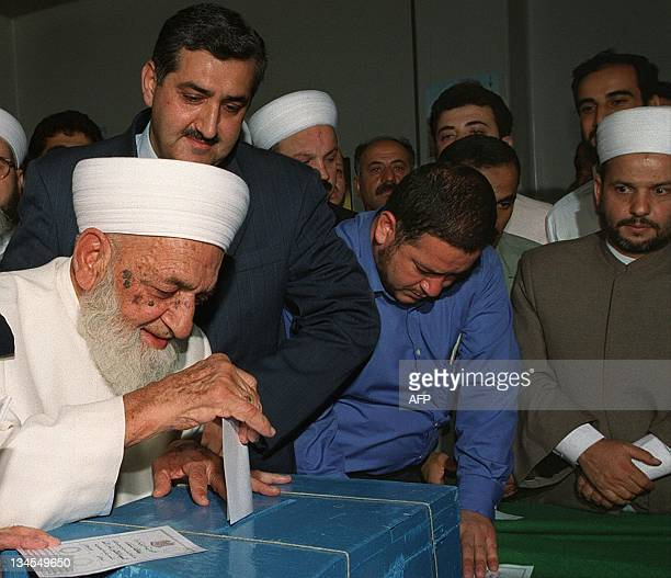 Syrian Sunni Mufti Sheikh Mohammed Kaftaro casts his presidential vote at a polling station in Damascus 10 July 2000 Bashar alAssad is the sole...