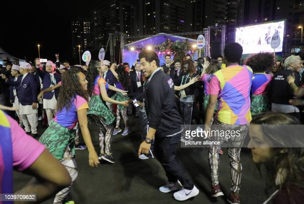 Syrian swimmer Rami Anis dances during the team welcome ceremony for the Refugee Olympic Team at Olympic Park Village prior to the Rio 2016 Olympic...