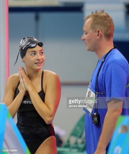 Syrian swimmer Yusra Mardini and her coach Sven Spannekrebs of Germany are seen during the Swimming Training Sessions at the Olympic Aquatics Stadium...