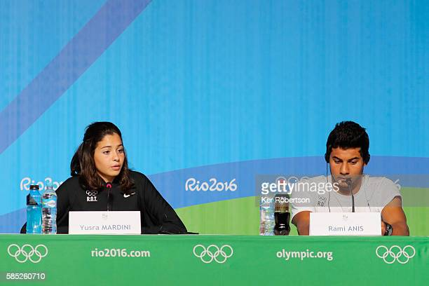 Syrian swimmers Yusra Mardini and Rami Anis of the Refugee Olympic Team attend a press conference on August 2, 2016 in Rio de Janeiro, Brazil.