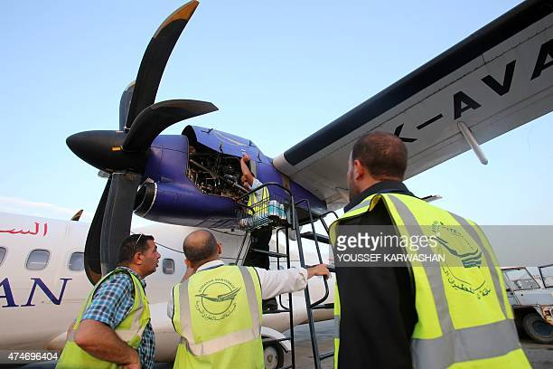 Syrian technicians inspect a Syrian airplane coming from the northern Syrian province of Qamishli on May 24 2015 at alBasel International Airport in...