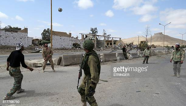Syrian troops play football in the ancient city of Palmyra after they recaptured the UNESCO world heritage site from the Islamic State group on March...