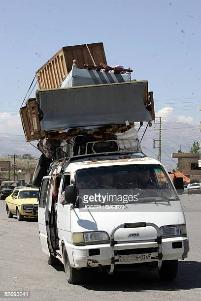 Syrian van loaded with furnitures crosses the LebaneseSyrian border crossing point of Masnaa 25 April 2005 Syrian troops were packing up and heading...