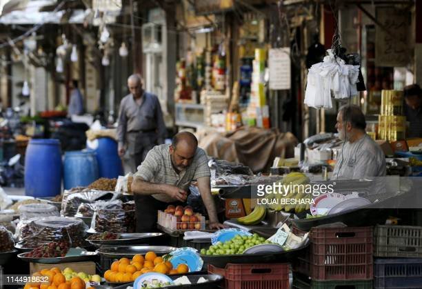 Syrian vendor displays fruits at a market in the capital Damascus on May 19 during the Muslim holy fasting month of Ramadan.