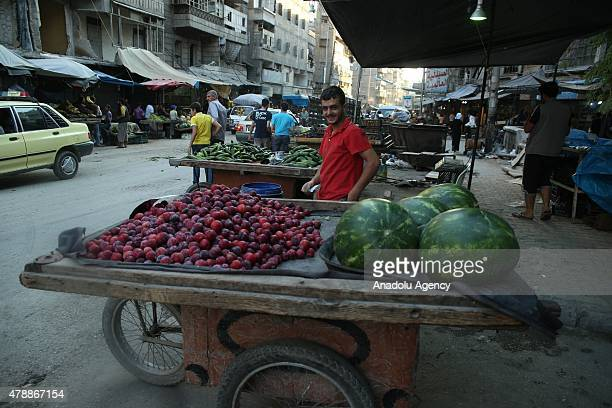Syrian vendors sell fruits on stands during the holy month of Ramadan in opponentheld historical bazaar which is heavily damaged by Asad regime...