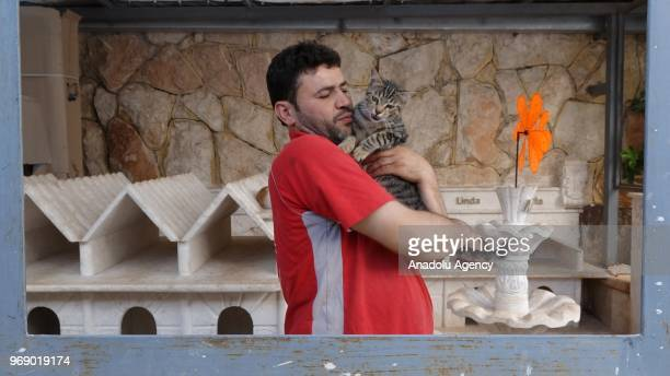 Syrian veterinary Mohammed Alaa alJaleel holds a stray cat at a cat shelter which hosts 150 stray cats and established to save stray cats due to the...