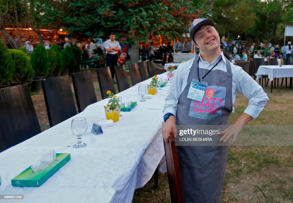 Syrian waiter with Down syndrome Abdel Rahman works at the Sucet ...