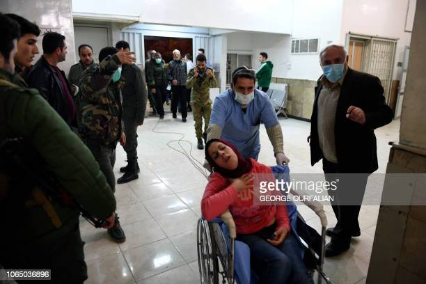A Syrian woman arrives for treatment at a hospital in the regime controlled Aleppo on November 24 2018 Official Syrian media accused the armed...