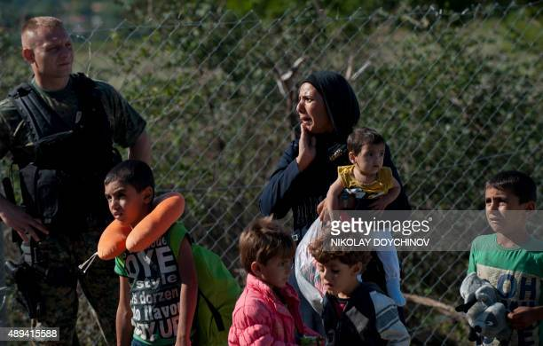 Syrian woman cries after loosing one of her children while migrants and refugees board the train heading to Serbia near the Greek-Macedonian border...