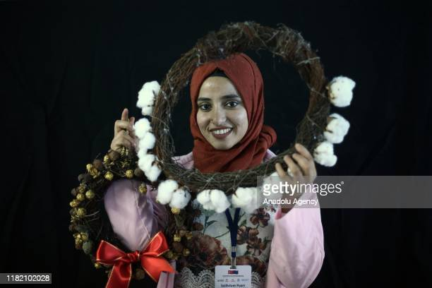 Syrian woman Emnine Fennus holds handiworks made in a course on art works handcrafts and souvenir production within a cooperative project named Ekmek...