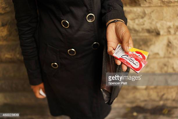 Syrian woman from Kafer Hend Syria sells chewing gum in a wealthy district of Beirut on November 16 2013 in Beirut Lebanon As the war in neighboring...