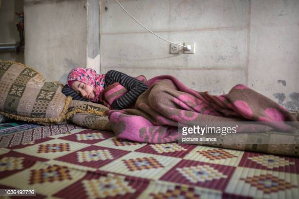 A syrian woman is seen sleeping in her place in Gazikent Gaziantep Turkey on 22/4/16 Tens of thousands of syrian refugees have moved in Gaziantep in...