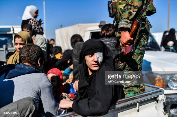 A Syrian woman looks back as civilians gather on the western front after fleeing the centre of Raqa on October 12 2017 Syrian Democratic Forces...