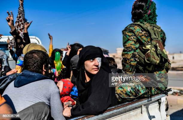 Syrian woman looks back as civilians gather on the western front after fleeing the centre of Raqa on October 12 2017 Syrian Democratic Forces Syrian...
