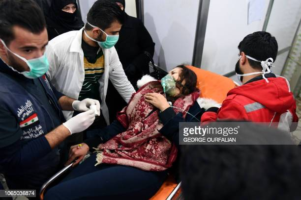 Syrian woman receives treatment at a hospital in the regime controlled Aleppo on November 24 2018 Official Syrian media accused the armed opposition...
