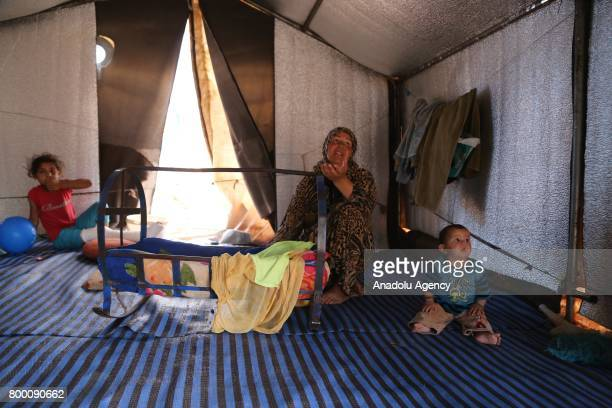 Syrian woman speaks inside of her tent during Muslim's holy month of Ramadan in Idlib Syria on June 23 2017 Ahead of Eid al Fitr Syrian people who...