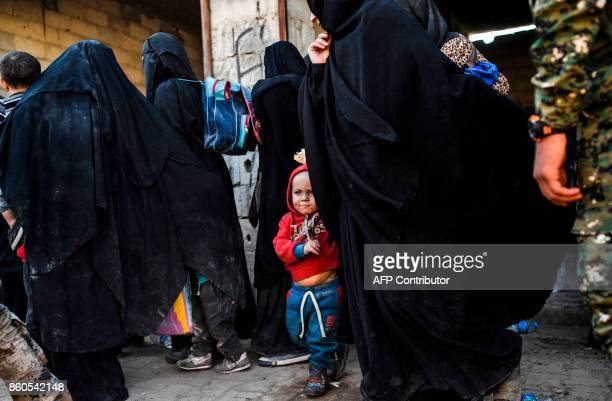 Syrian women and children gather on the western front after fleeing the centre of Raqa on October 12 2017 Syrian Democratic Forces Syrian fighters...