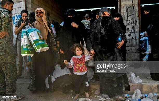 TOPSHOT Syrian women and children gather on the western front after fleeing the centre of Raqa on October 12 2017 Syrian Democratic Forces Syrian...