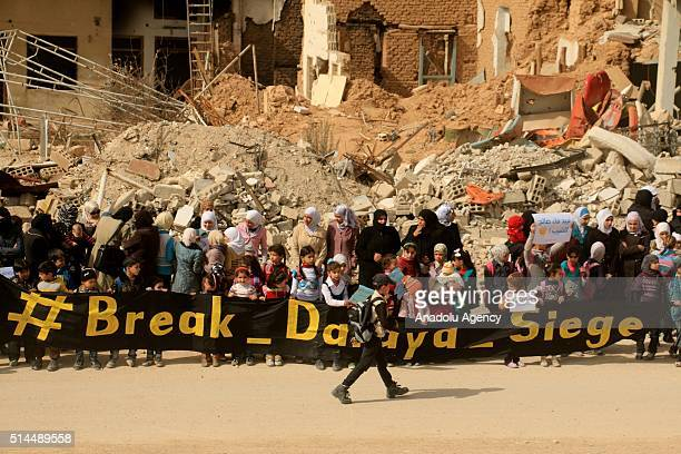 Syrian women and kids stage a protest against Assad Regime's siege to the town of Darayya in Damascus Syria on March 9 2016 Syrians demand Assad...