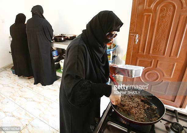 Syrian women cook at the Eve Kitchen in Khartoum on November 25 as part of a project to support Syrians who have taken refuge in the Sudanese capital...