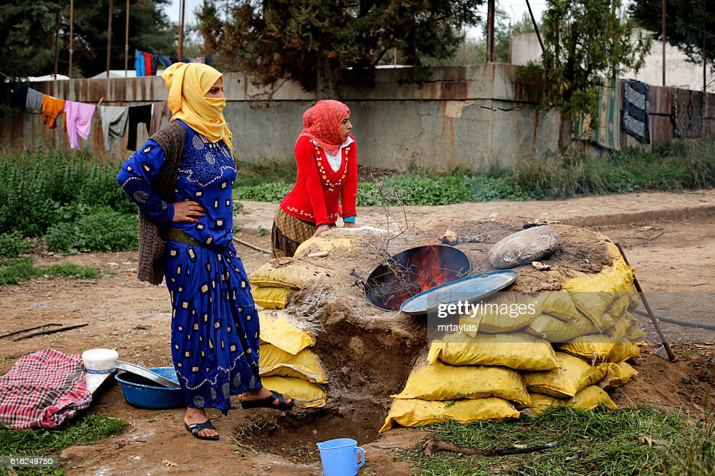 Syrian women making bread : Stock Photo