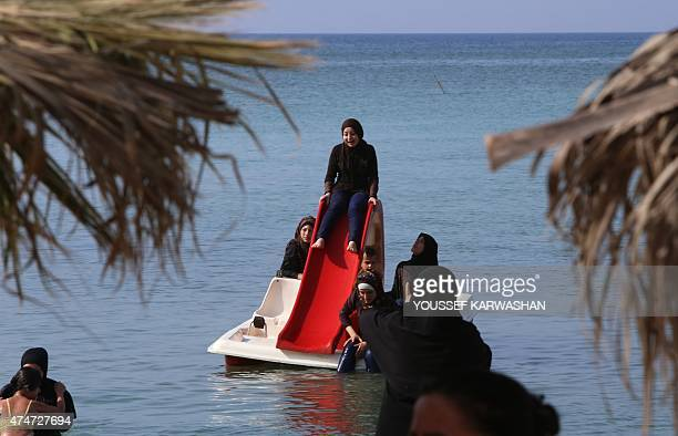 Syrian women play on the beach in the Syrian government stronghold of Latakia in the coastal province of the same name on May 25 2015 At least four...