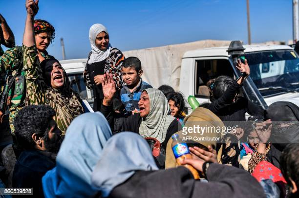 Syrian women rejoice as civilians gather on the western front after fleeing the centre of Raqa on October 12 2017 Syrian Democratic Forces Syrian...