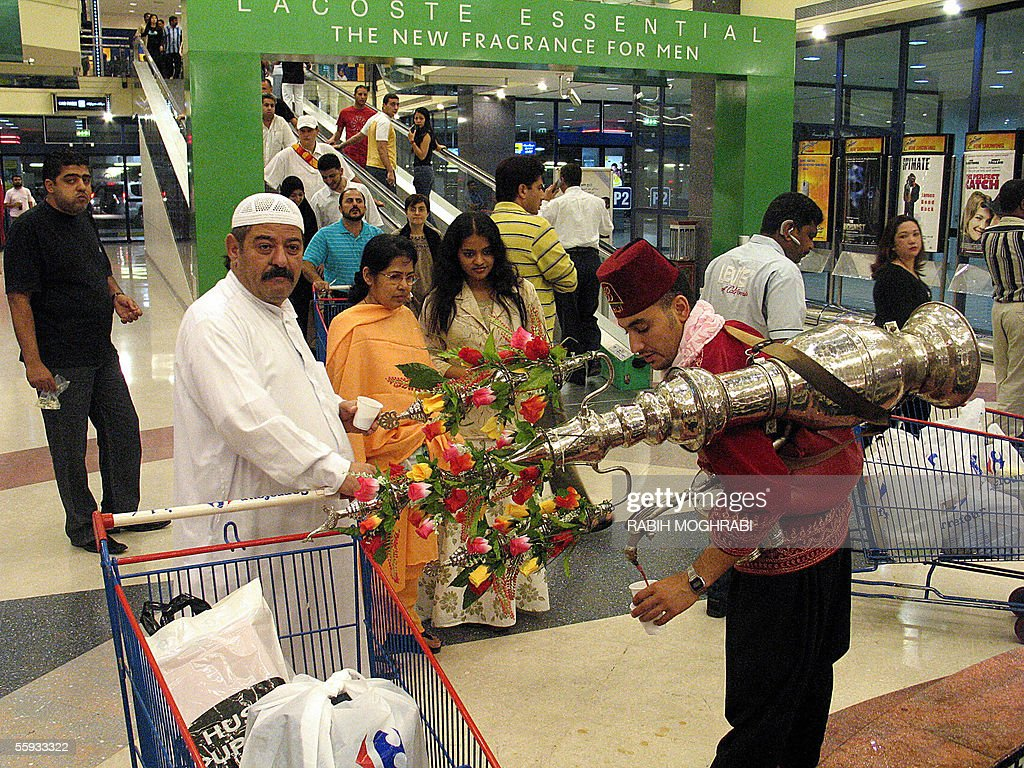 A Syrian worker wearing traditional clothes offers the Ramadan 'Tamr Hindi' juice (date juice) to Dubai residents after the breaking of the fast in Dubai 16 October 2005. Muslims around the world abstain from eating, drinking, smoking and sex during daylight hours during the holy month of Ramadan. AFP PHOTO/Rabih MOGHRABI