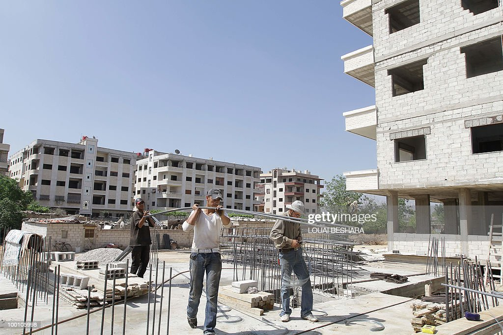 MABARDI Syrian workers construct a building in Damascus on May 20, 2010. The price of property in Syria has sky-rocketed in Syria, where an apartment can be sold for three million USD, an inaccessbile dream for most Syrians.
