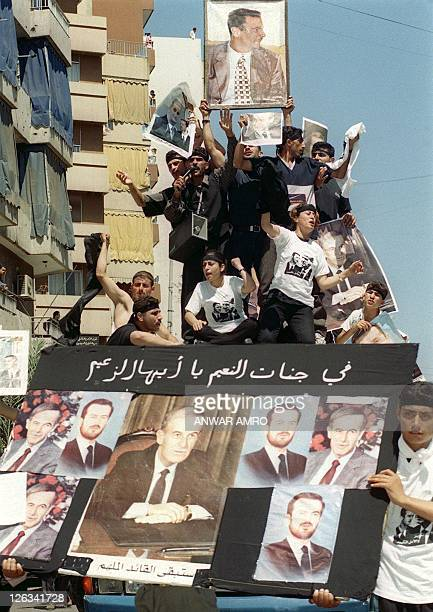 Syrian workers mourn their president Hafez alAssad 13 June 2000 in Beirut A march was organized in the Lebanese capital to coincide with the funeral...