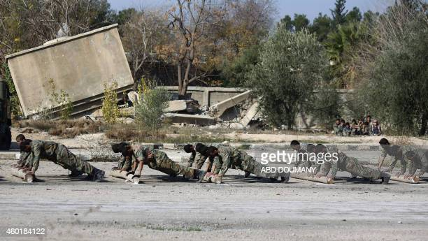 Syrian youths take part in their last training on December 8 2014 before being sent to the frontline along with rebel fighters from the Jaysh alIslam...