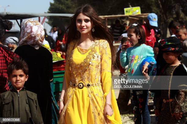 SyrianKurds gather in the northeastern Syrian town of Qamishli as they celebrate Noruz the Kurdish New Year on March 21 2018 For Syria's Kurds Nowruz...