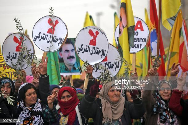 Syrian-Kurds march during a demonstration in the northeastern Syrian city of Qamishli on January 24 against the Turkish assault on the border enclave...
