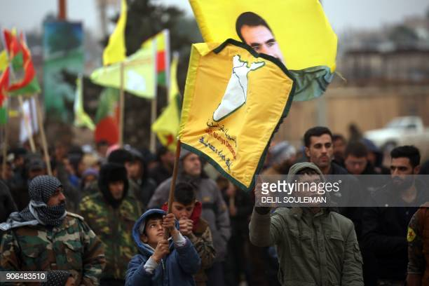 SyrianKurds march during a protest in support of Afrin on January 18 in the northern Syrian town of Jawadiyah Turkish President Recep Tayyip Erdogan...