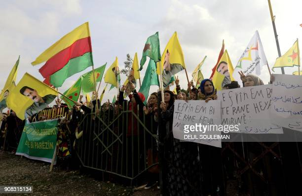 SyrianKurds take part in a demonstration in the town of Amuda some 30 kilometres west of Qamishli a Kurdishmajority city in northeastern Hasakeh...