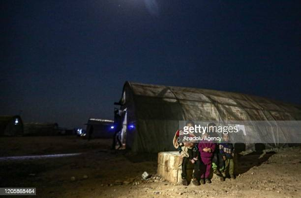 Syrians are seen at Maâarrat Misrin refugee camp on March 06, 2020 in Idlib, Syria. Civilians, who have been fled due to the ongoing attacks in the...