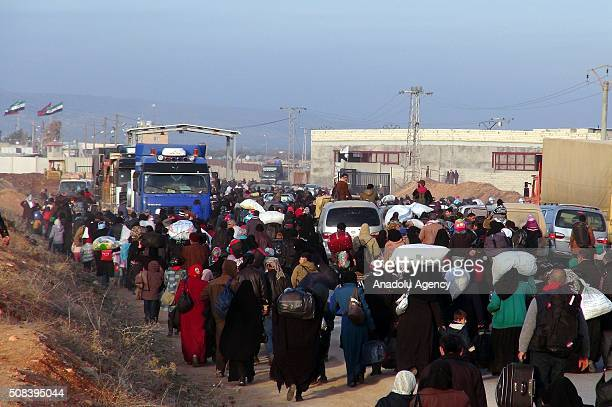 Syrians are seen at the Esselame Border Gate across from the Turkish province of Kilis as they migrate after the war crafts belonging to Russian army...