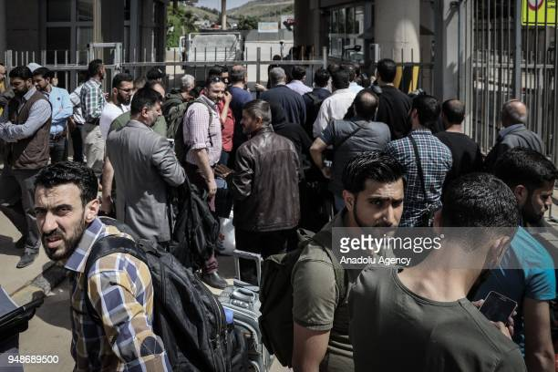 Syrians are seen with their belongings as they wait to return to Syria's safe zones after Turkish Armed Forces and Free Syrian Army cleared Syria's...