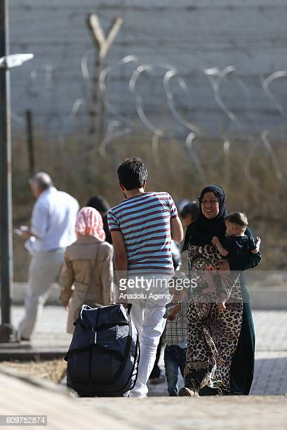 Syrians are seen with their belongings in the Karkamis district of Gaziantep Turkey on September 22 2016 2857 Syrian people return to Jarabulus...