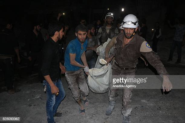 Syrians carry a death body after War crafts belonging to Russian army carried out an airstrikes to Jerusalem field hospital at Sukeri region of...