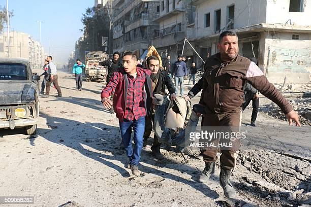 Syrians carry the body of a victim following a reported Syrian regime air strike in a rebelcontrolled area in the northern city of Aleppo on February...