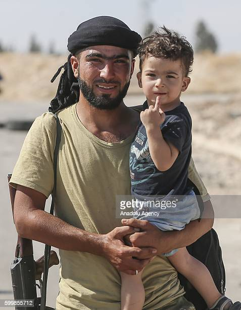 Syrians carry their belongings as they return to their homes back in Jarabulus Aleppo Syria on September 7 2016 A 250person group of Syrians in...